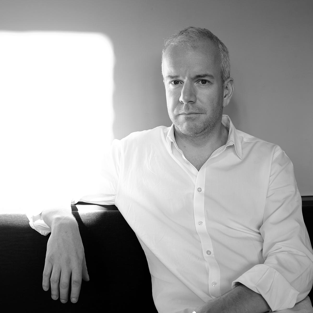Black and white corporate portrait for Studio of Art and Commerce London by Julian Hanford