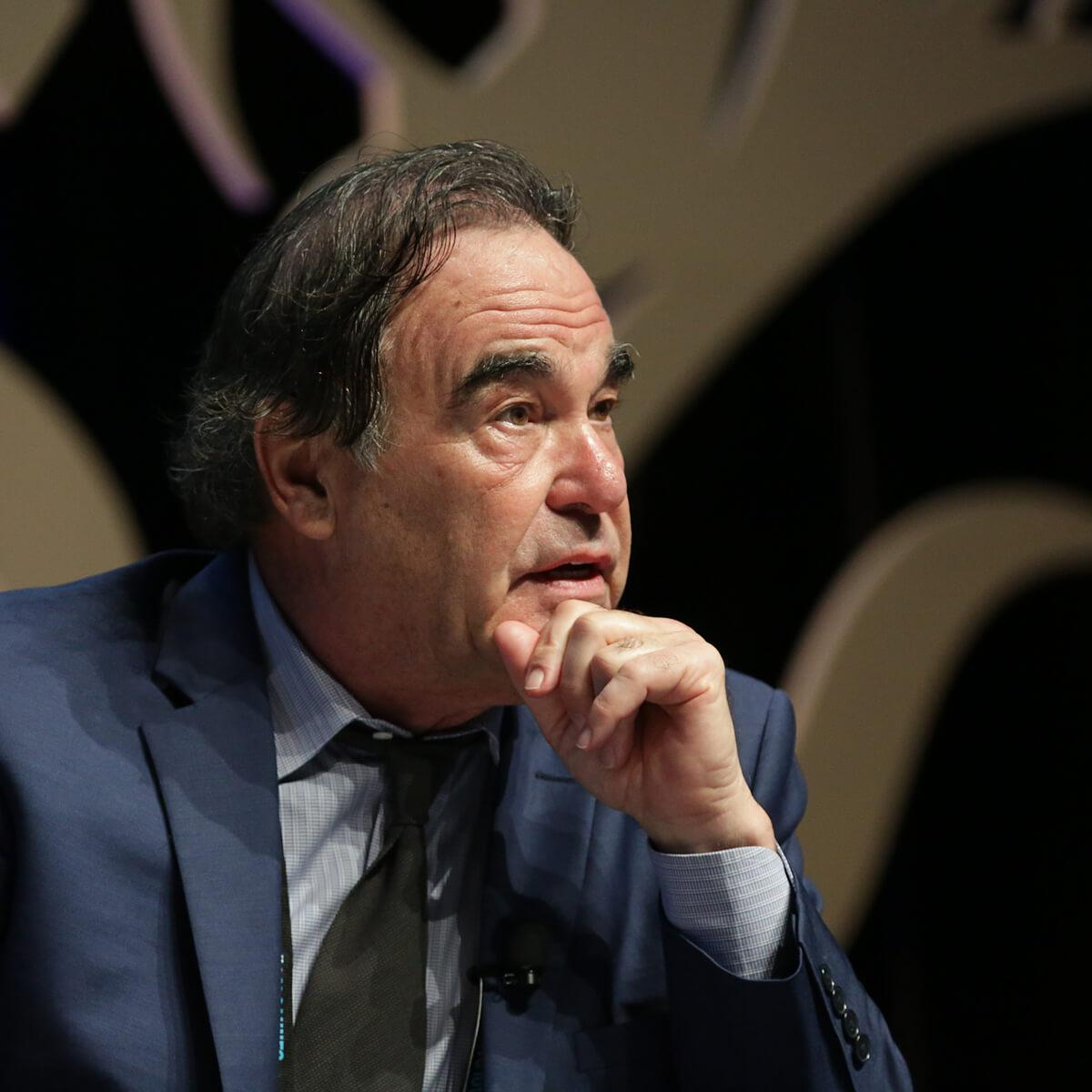 Portrait of American writer and filmmaker, Oliver Stone by photographer Julian Hanford